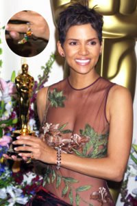 Halle Berry wearing the pumpkin diamond on her pinky finger.