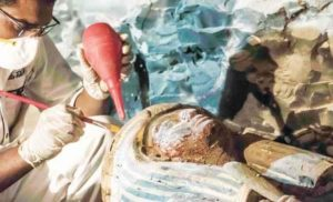 Egyptian Archaeologist restoring artifacts found in the tomb.